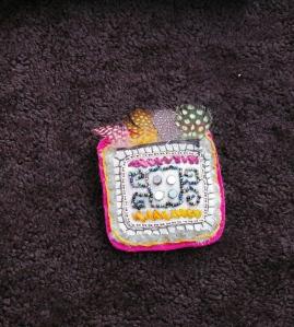 broche maya plume